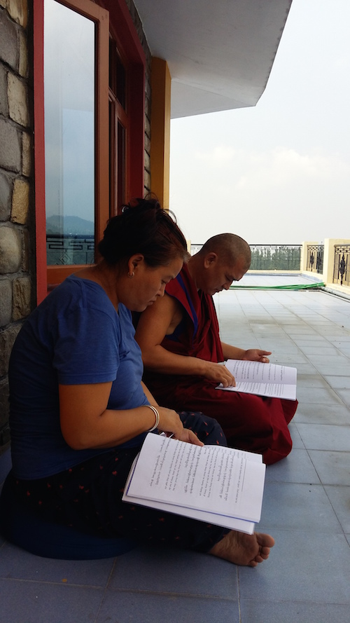 Our teachers Geshe-La and Sangmo-La with Sur text